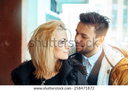 young lovers looking at each other happy look. Horizontal color photo - stock photo