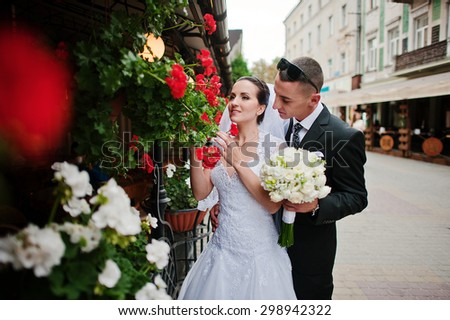 Young lovers wedding couple near flowers - stock photo