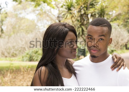 Young Loving Couple at the park holding each other