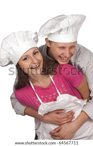Young loving couple cooks. Over white background - stock photo