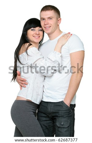 Young loving couple embracing on a white isolated background