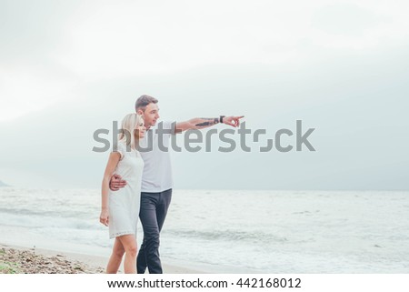 young loving couple having fun on beach