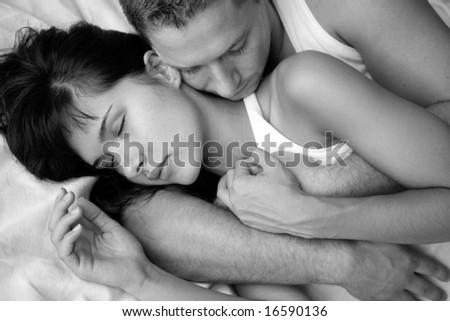 Young loving couple in a sensual mood,black and white - stock photo