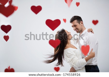 Young loving couple in studio - stock photo