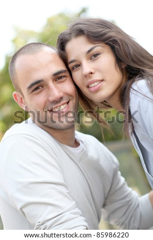Young loving couple in town - stock photo