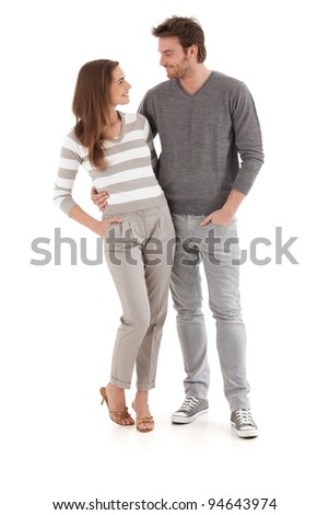 Young loving couple looking at each other, smiling, hugging.? - stock photo
