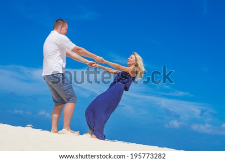 young loving couple on tropical beach background