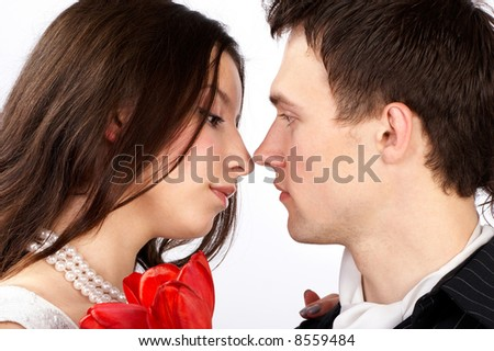 Young loving  couple talking. Over white background