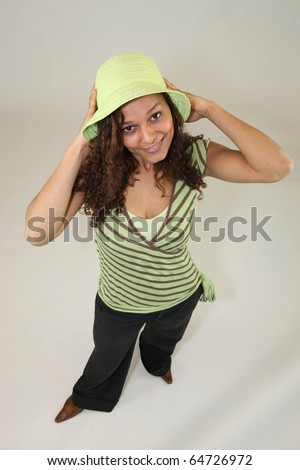 Young M?tis woman with a green hat - stock photo