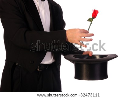 young magician performing with high hat  and red rose