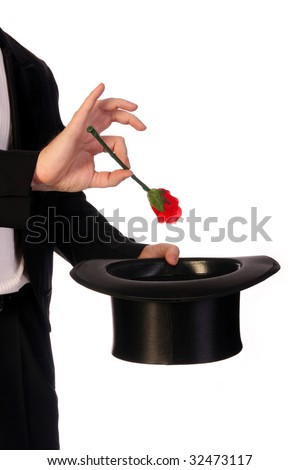 young magician performing with high hat  and red rose - stock photo