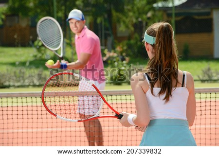 Young male and female tennis players, while playing tennis on the tennis court