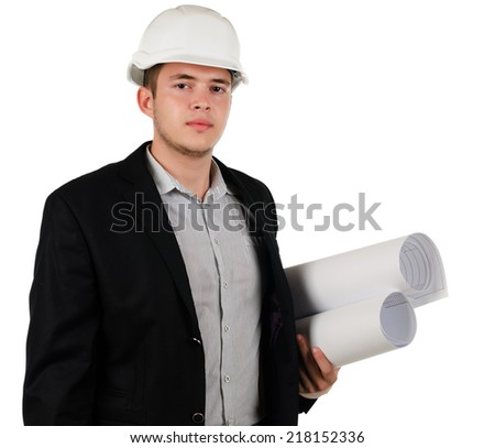 Young male architect or engineer wearing a hardhat standing with blueprints rolled up under his arm looking at the camera with a serious expression, on white - stock photo