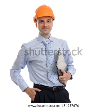 Young male architect wearing helmet and holding laptop, isolated on white background - stock photo