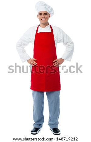 Young male chef posing with hands on his waist - stock photo