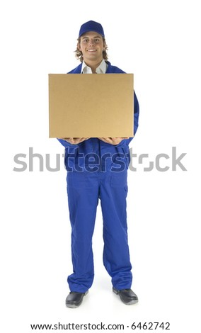 Young male courier holding carton box. He's looking at camera. Isolated on white background. Front view - stock photo