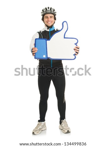 Young Male Cyclist Holding Thumb-up Sign - stock photo