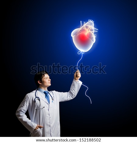 Young male doctor cardiologist with heart symbol