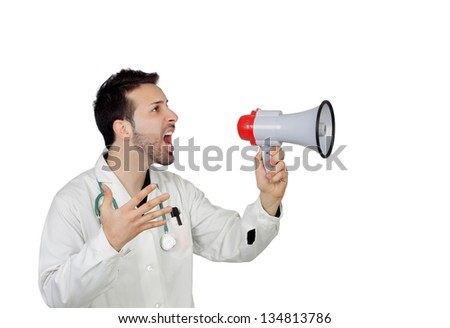 Young Male Doctor Shouting Through Megaphone Over White Background - stock photo