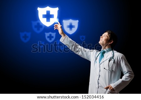 Young male doctor touching digital lightened image