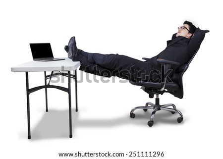 Young male entrepreneur sitting on armchair while daydreaming, isolated on white background - stock photo