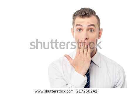 Young male executive with shocked facial expression - stock photo