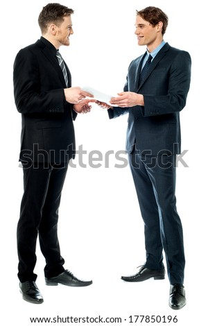 Young male executives discussing their financial reports - stock photo