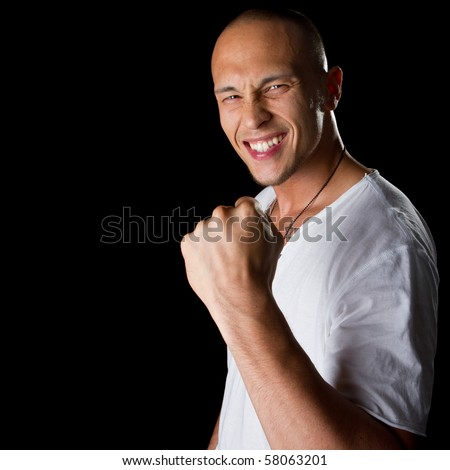 Young male filipino model over a black background is gesturing with his hand. - stock photo