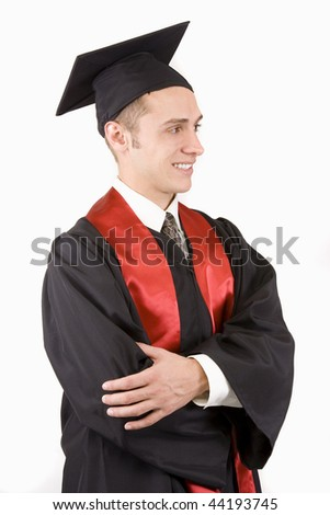 Young male graduate in cap and gown