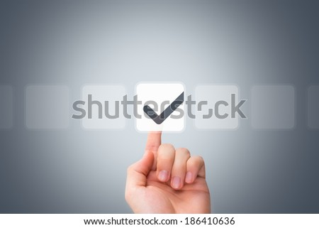 Young male hand touching, pressing modern button and ticking check box out of empty boxes on digital screen interface on virtual background.
