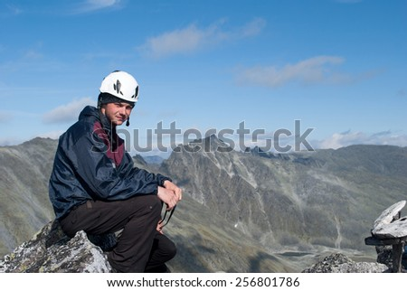 young male hiker sitting on rest, Ural mountains, Russia - stock photo