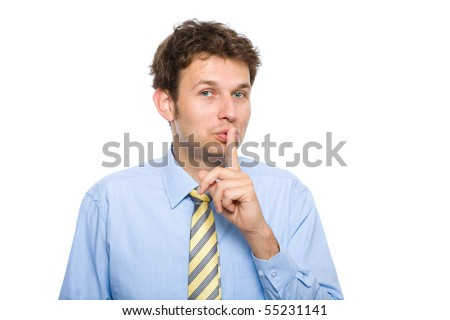 young male holds finger on his lips, gesture, quiet please, studio shoot isolated on white background - stock photo
