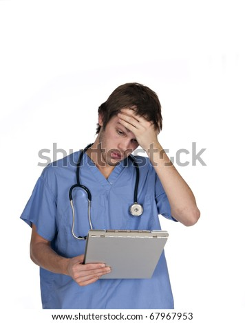 young male in blue scrubs holding head while looking at clipboard - stock photo