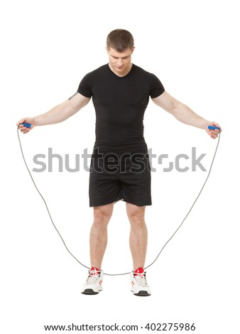 Young male jumping with jumping rope isolated at white background - stock photo