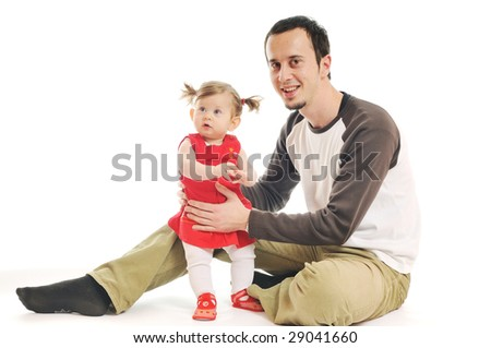young male man parent play with beautiful little baby - stock photo