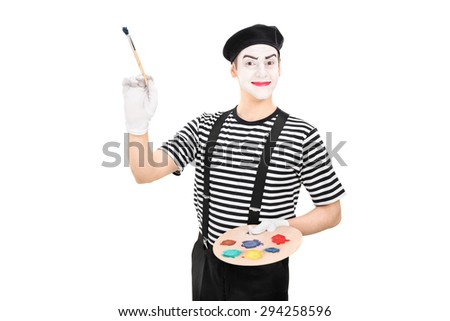 Young male mime artist holding a paintbrush and a color palette isolated on white background - stock photo