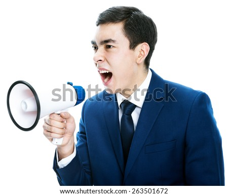 young male office worker shouting into megaphone. Isolated on white