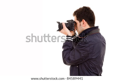 Young male photographer with camera, isolated on white