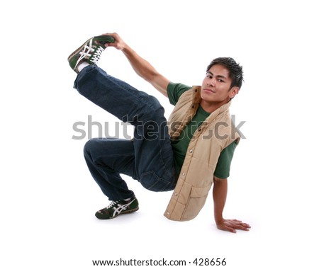 Young male posing while breakdancing,