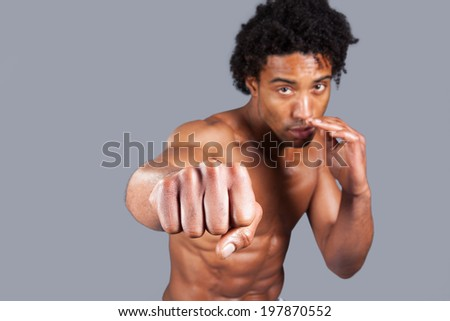 young male punching screen  - stock photo