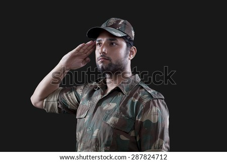Young male soldier saluting - stock photo