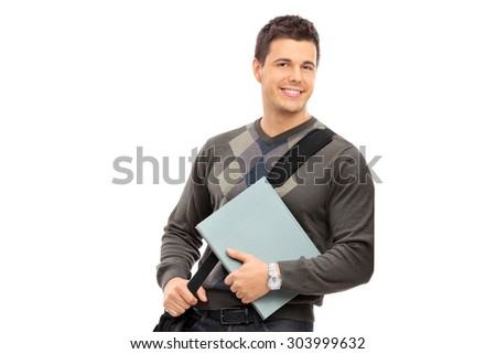 Young male student holding a notebook isolated on white background - stock photo