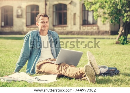 Young male student programmer work study outdoors