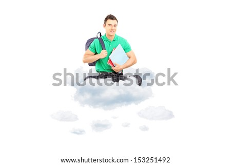 Young male student with school bag and notebooks sitting on a cloud isolated on white background