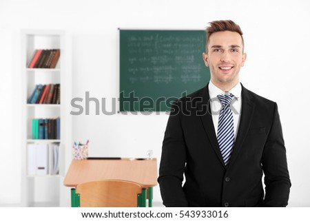 Young male teacher in classroom