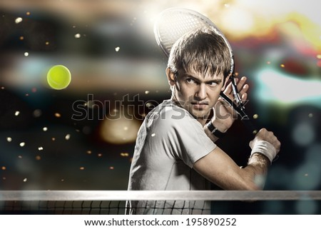 Young male tennis player hitting ball - stock photo