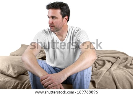 young male waking up and looking worried about the day - stock photo