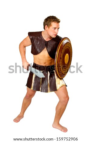 young male warrior with a shield - stock photo