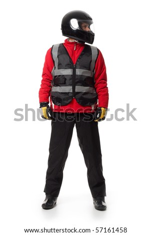 Young male wearing motorcycle suit and helmet, looking to one side. - stock photo