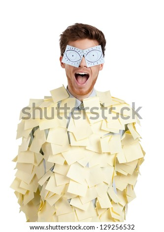 Young male with eyes painted on stickers, covered with yellow sticky notes